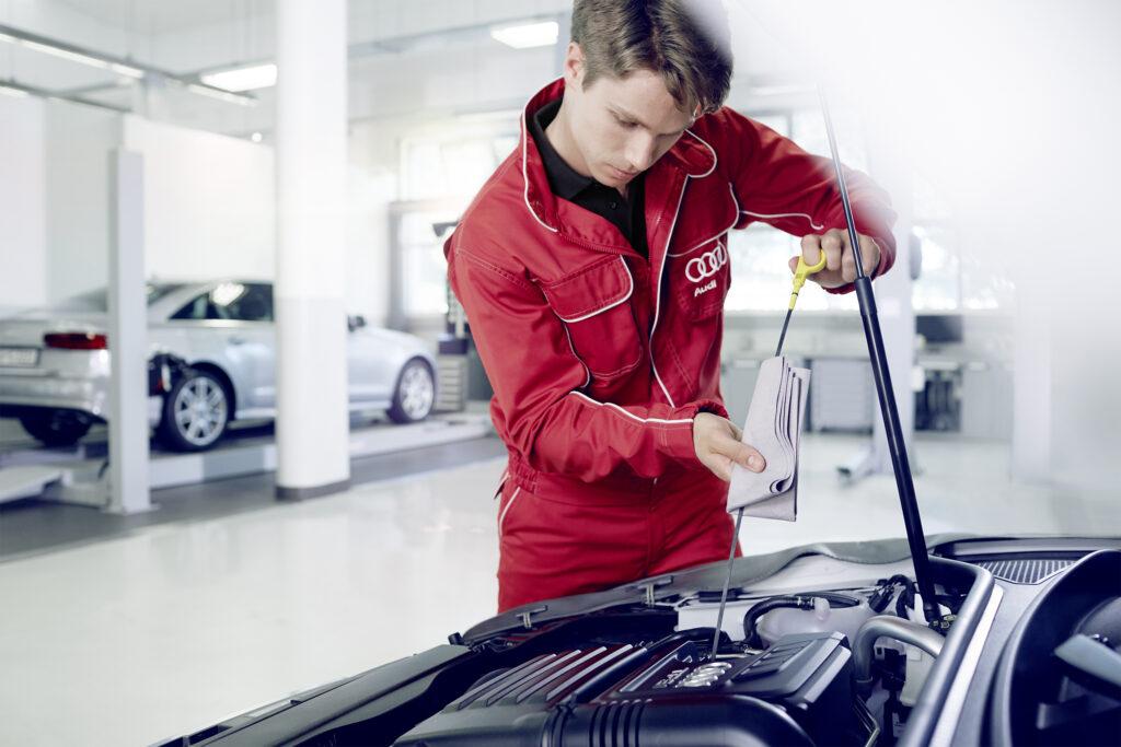 Audi mechanic working on car